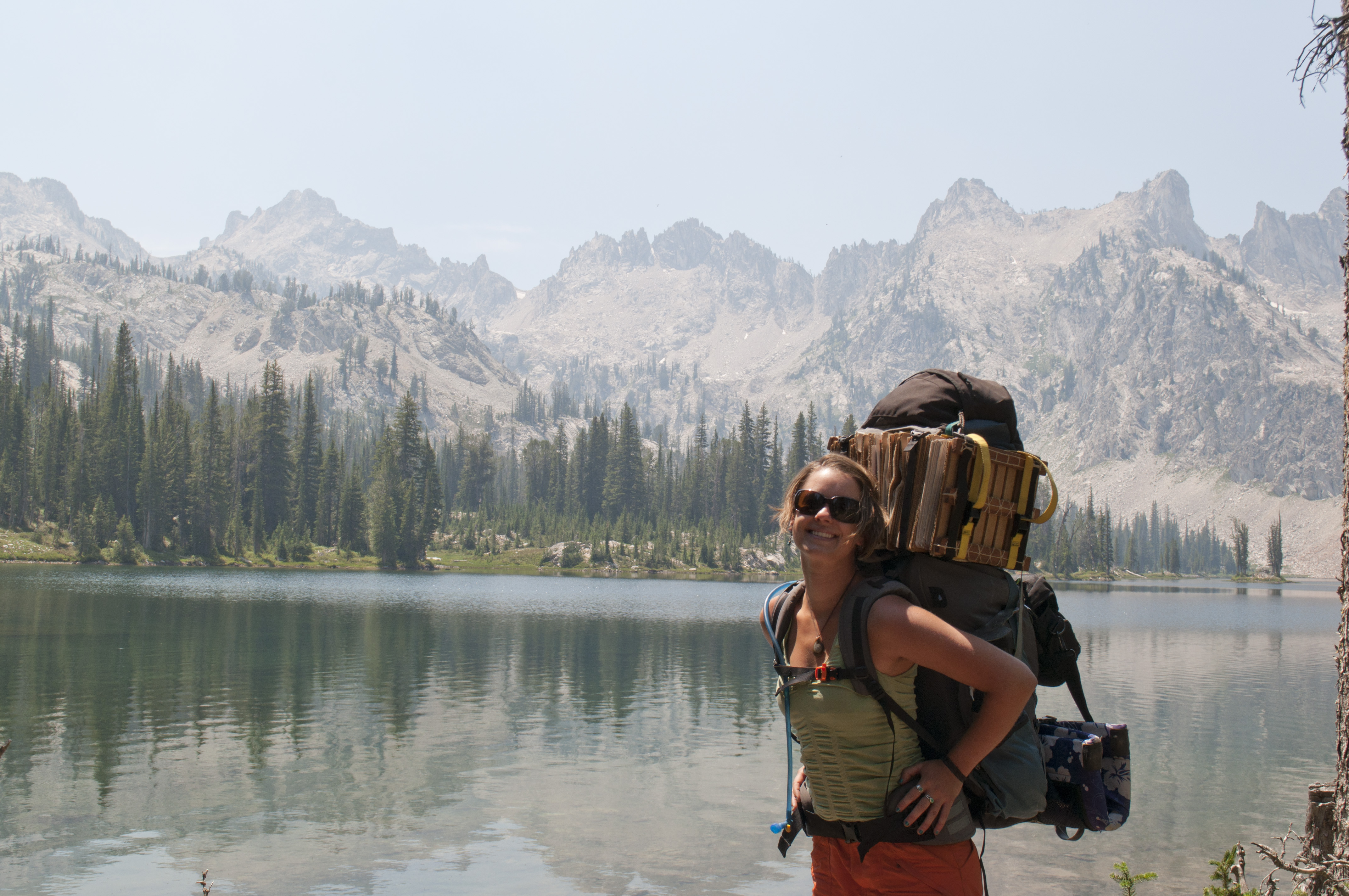 Hannah-next-to-mountain-lake-with-backpack
